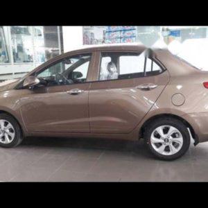 Hyundai Grand i10 sedan màu vàng cát